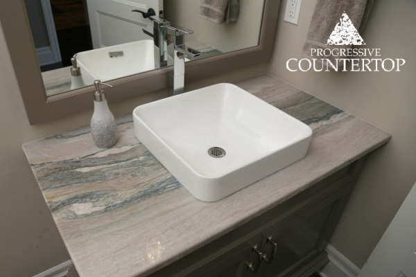 Bathroom vanity by Progressive Countertop with Aquarella granite