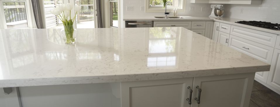 Bright White & Unstoppable Kitchen Design by Progressive Countertop!