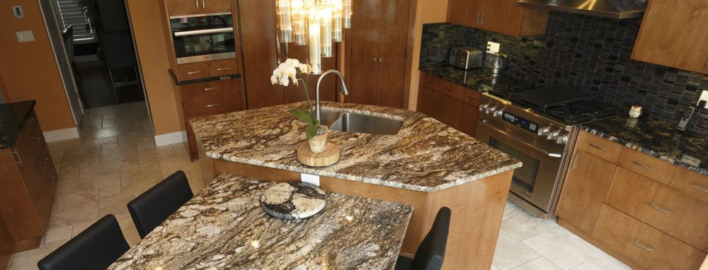 A beautiful custom kitchen with two kinds of granite from Progressive Countertop