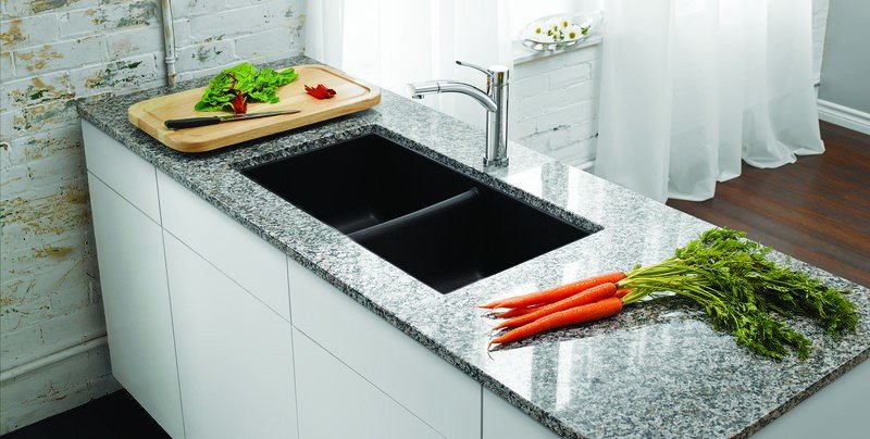 Blanco U2 Silgranit Sink shown in island with quartz counter top and white cabinets - available from Progressive Countertop