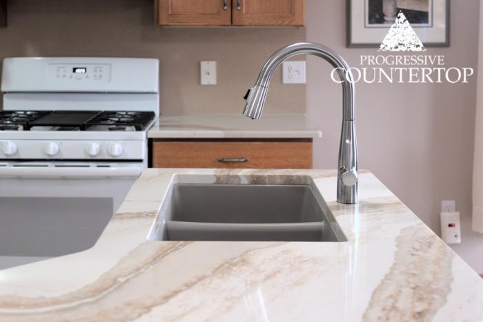 Cambria® Brittanicca Gold™ Quartz Kitchen Countertop Sink Closeup (gold, beige, creamy quartz)