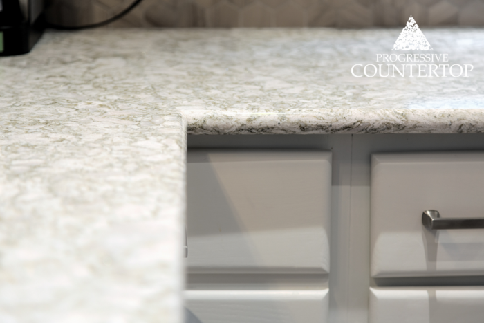 Cambria® Crowndale ™ Quartz Kitchen Countertop Close Up of Design (cream, beigh and darker tans)