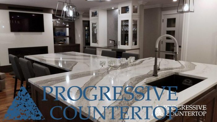 Skara Brae by Cambria T-shaped island countertop and Gigantec Porcelain fireplace feature wall by Progressive Countertop